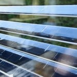 Solar window blinds that block the Sun while generating solar power